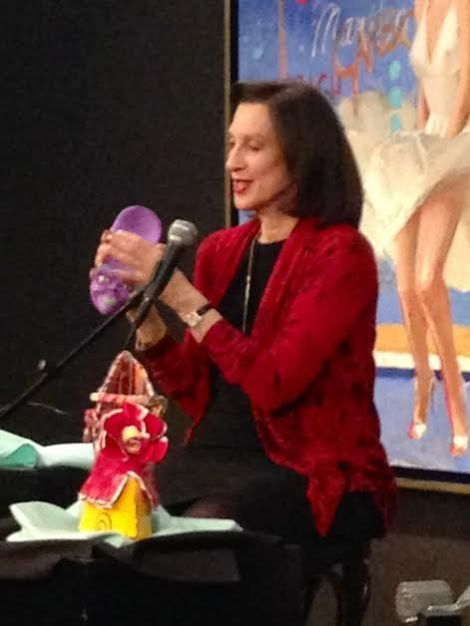 Jane Weitzman showing off her fantasy shoe collectibles